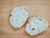 Fresh homemade herbal bread slice on bamboo cutting board. Homem Royalty Free Stock Images