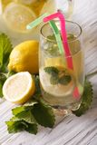Fresh homemade lemonade in a glass closeup. vertical Royalty Free Stock Photography