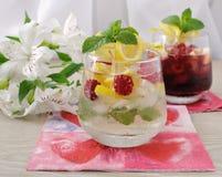 Fresh homemade lemonade with mint and raspberries. A glass of fresh homemade lemonade with mint and raspberries Stock Photo