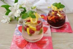 Fresh homemade lemonade with mint and raspberries. A glass of fresh homemade lemonade with mint and raspberries Stock Image
