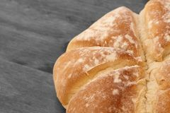 Fresh homemade loaf of bread on wooden background Royalty Free Stock Images