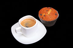 Fresh homemade muffin, cake and white cup of Cappuccino on dark background. Stock Image