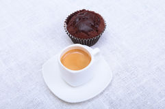 Fresh homemade muffin, cake and white cup of Cappuccino on white background. Royalty Free Stock Images