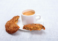 Fresh homemade muffin, cake and white cup of Cappuccino on white background. Stock Image