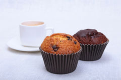 Fresh homemade muffin, cake and white cup of Cappuccino on white background. Stock Photos