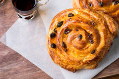 Fresh homemade pain au raisins. Over wooden background, top view Stock Photography