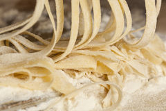 Fresh Homemade Pasta. Against a background Royalty Free Stock Photography