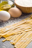Fresh homemade pasta. On kitchen table Royalty Free Stock Image