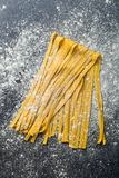 Fresh homemade pasta. On kitchen table Royalty Free Stock Photography