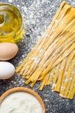 Fresh homemade pasta. On kitchen table Royalty Free Stock Photos