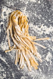 Fresh homemade pasta. On kitchen table Royalty Free Stock Photo