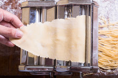 Fresh homemade pasta. And  machine on kitchen table Royalty Free Stock Image