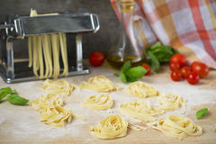 Fresh homemade pasta machine pasta, basil,. tomatoes on a wooden Stock Images