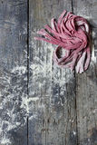 Fresh homemade pasta tagliatelle with beetroot on rustic wooden table Royalty Free Stock Photography