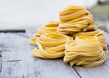 Fresh Homemade Pasta. On the wooden table Royalty Free Stock Photos