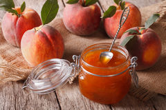 Fresh homemade peach jam in a glass jar close-up. Horizontal Stock Photography