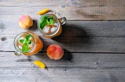 Fresh Homemade Peach Sweet Tea with Mint Stock Photography