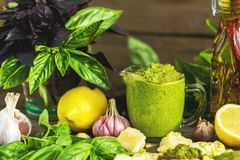 Fresh homemade pesto sauce close up and food ingredients. For making pesto. Shallow depth of the field, toned and processing photo royalty free stock photos
