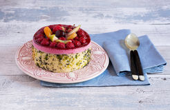 Fresh homemade pie with fruit and berries on top on wooden table Royalty Free Stock Images