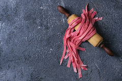Fresh homemade pink pasta tagliatelle Royalty Free Stock Images