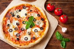 Fresh Homemade Pizza Margherita with Olives and Basil Stock Image