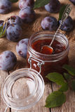 Fresh homemade plum jam in a jar on the table close-up. vertical Stock Photos