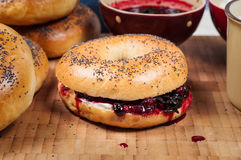 Fresh homemade Poppy bagels bread with cup of milk, cream cheese Stock Image