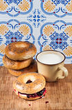Fresh homemade Poppy bagels bread with cup of milk, cream cheese Stock Photos