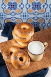 Fresh homemade Poppy bagels bread with cup of milk Stock Image