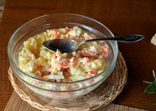 Fresh Homemade Potato Salad with Eggs and Carrots On Glass Bowl Royalty Free Stock Photography