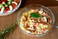 Fresh Homemade Potato Salad with Eggs and Carrots On Glass Bowl Stock Image