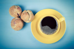 Fresh homemade profiteroles and cup of coffee on blue wooden tab Royalty Free Stock Photos