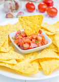 Fresh homemade salsa with nachos. Closeup Stock Photos