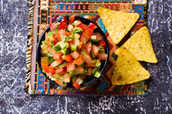 Fresh homemade salsa. With vegetables and chips nachos. Selective focus Stock Images