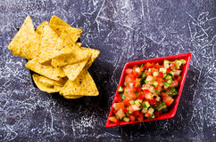 Fresh homemade salsa. With vegetables and chips nachos. Selective focus Stock Image