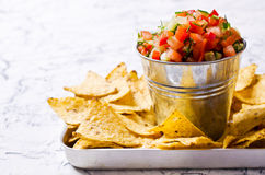 Fresh homemade salsa. With vegetables and chips nachos. Selective focus Stock Photo