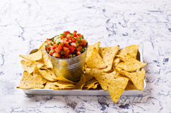 Fresh homemade salsa. With vegetables and chips nachos. Selective focus Royalty Free Stock Photos