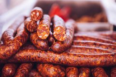 Home made smoked sausage. Fresh homemade smoked sausage to eat at the market, selective focus and small depth of  field Stock Photography
