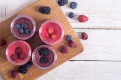 Fresh homemade smoothies. With berries on rustic background . Top view , copy space Royalty Free Stock Photo
