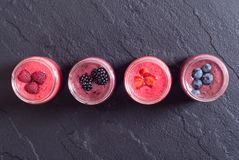 Fresh homemade smoothies. With berries on rustic background . Top view Stock Images
