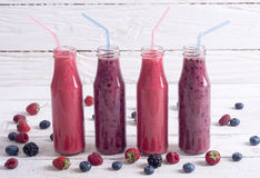 Fresh homemade smoothies. With berries on rustic background Royalty Free Stock Photography