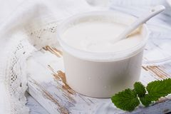 Fresh homemade sour creme on white wooden table. Farm product. Copy space Royalty Free Stock Photos