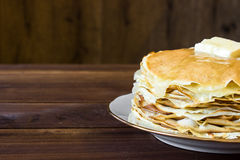 Fresh homemade stack of crepes with butter Stock Photos