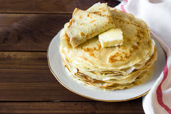 Fresh homemade stack of crepes with butter Royalty Free Stock Images