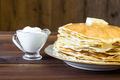 Fresh homemade stack of crepes with butter Stock Photography