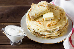 Fresh homemade stack of crepes with butter Royalty Free Stock Photography