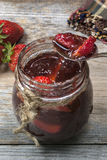 Fresh homemade Strawberry jam. On a table stock photography