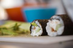 Fresh Homemade Sushi Roll. With salmon, rice, olives and nori. closeup Royalty Free Stock Photography