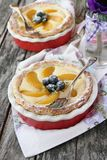 Fresh homemade tart with cream cheese filling,peach and blueberries Royalty Free Stock Photo