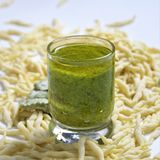 Fresh homemade pasta Italian trophy and agniolotti on a light background with traditional basilic souce pesto. Fresh homemade uncooked pasta Italian trophy and royalty free stock photography